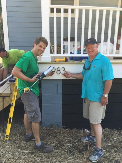 Richard and Steve Kendrick of Structures making sure the house numbers are perfect