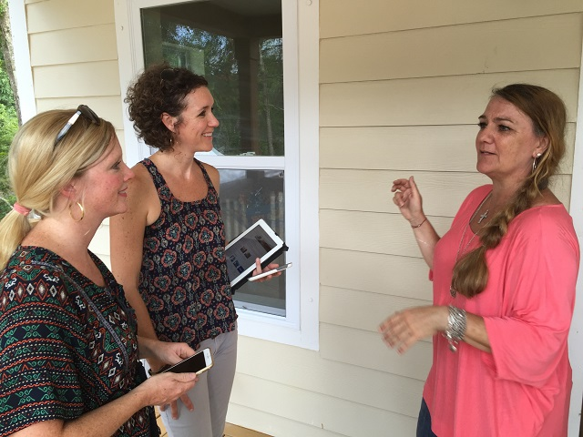 Our director of design, Allison Casper, and Deborah Way of Structures discuss paint colors with the homeowner