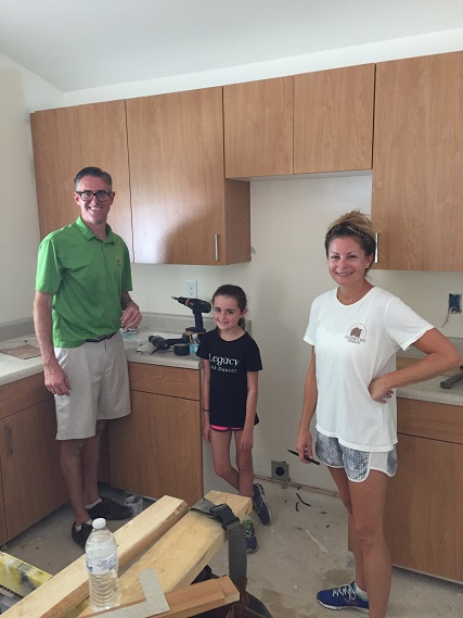 Our amazing cabinet designer, Bryan Reiss, and his family put the final touches on the kitchen
